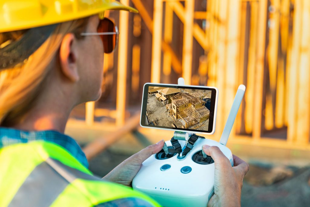 photo of contractor use controller of a drone